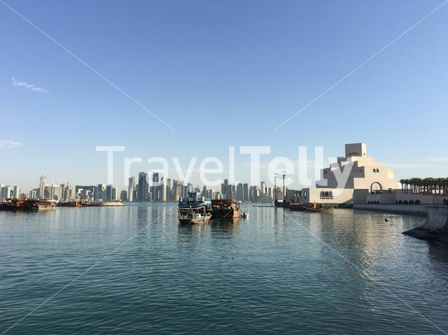 The Museum of Islamic Art on the Corniche with traditional Dhow, Arab sailing vessels in the Dhow Harbour in Doha Qatar