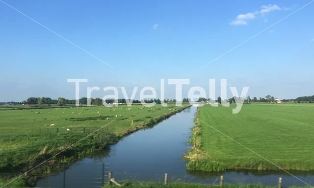 River between farmland in The Netherlands