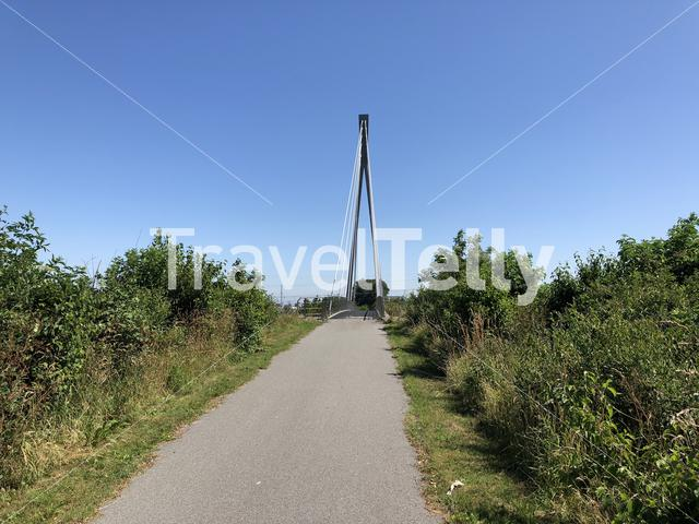 Bicycle bridge over the highway towards the city Franeker in Friesland The Netherlands