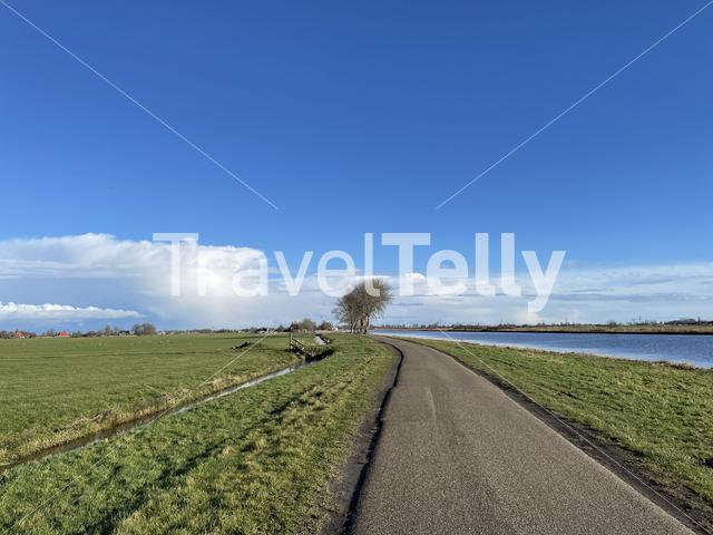Road next to a canal on a winter day in Friesland The Netherlands