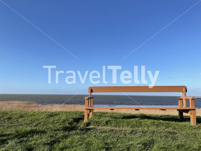 Bench at the dyke of the IJsselmeer around Gaast in Friesland, The Netherlands
