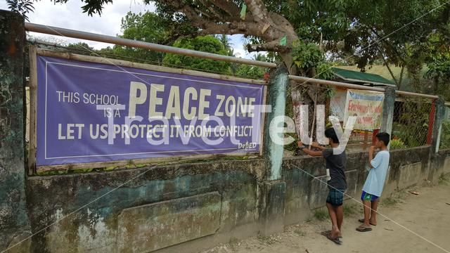Peace Zone sign at school in Port Barton town