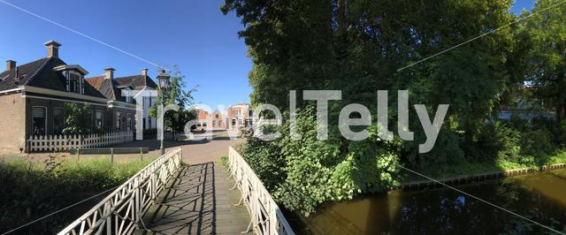 Panorama from a canal in Nijland, Friesland The Netherlands