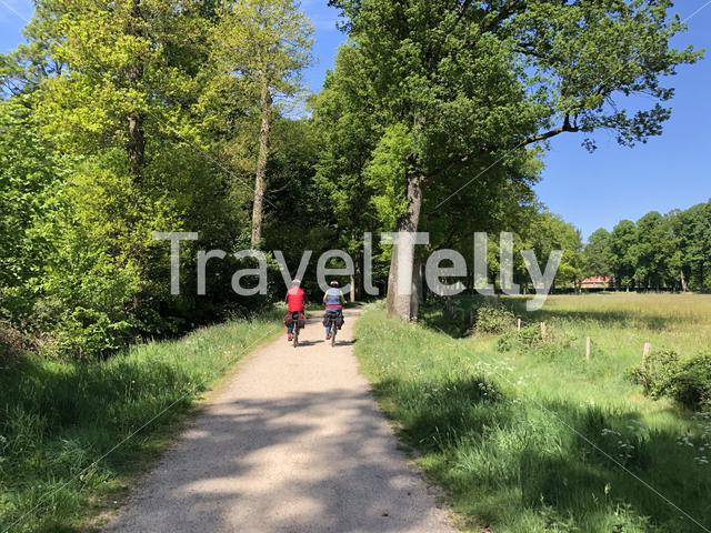 Tourists cycling in the nature around Huis Bergh castle in 's-Heerenberg, The Netherlands