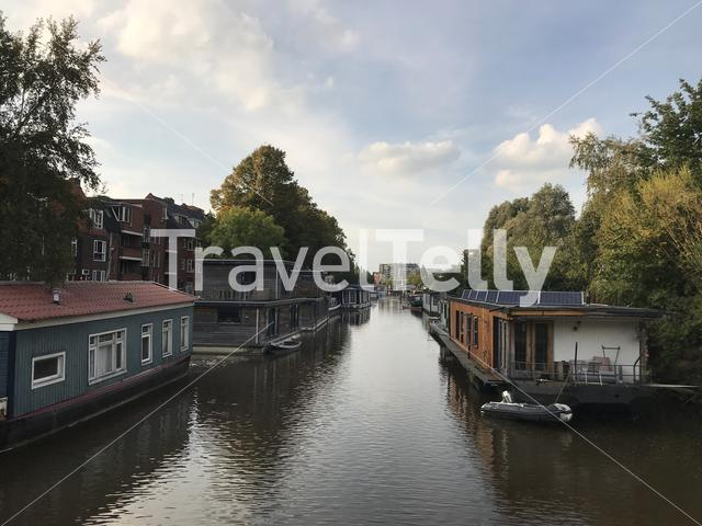 Canal with houseboats in Groningen The Netherlands