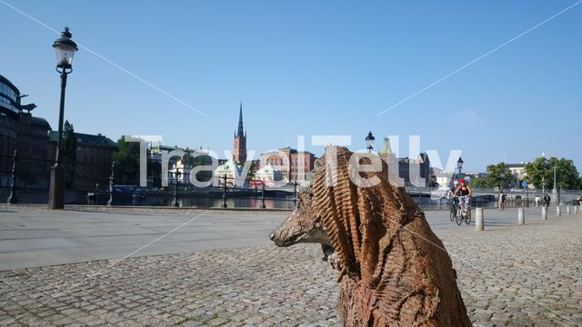 Rag and bone with a blanket statue in Stockholm with the Riddarholm Church at the background