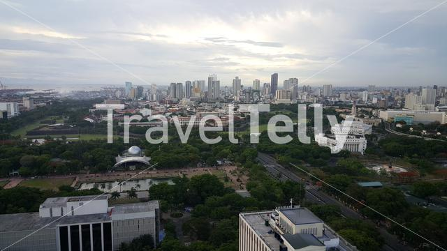 Rizal park and skyline Manila seen from rooftop