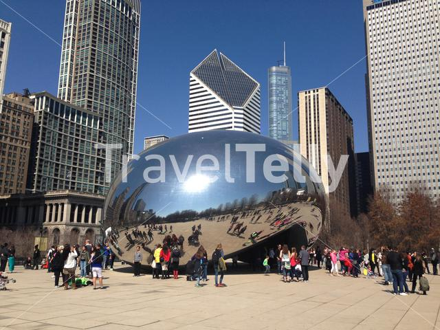Cloud Gate is a huge outdoor sculpture shaped like a bean & allowing for views from its many mirrored sides