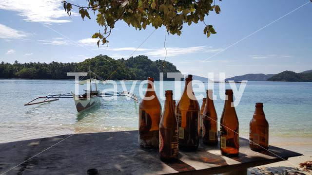Bottles of beer at tropical island near Port Barton