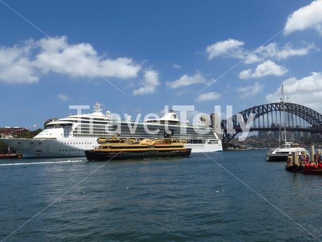 Circular key and harbour bridge with cruise ship and ferry in Sydney, Australia