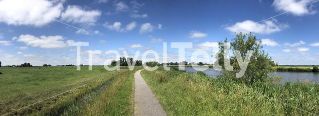 Bicycle path next to the Dokkumer Ee canal in Friesland, The Netherlands