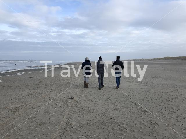 People walking at Texel beach in The Netherlands