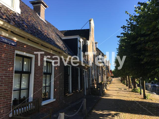 Houses next to a canal in Sloten Friesland The Netherlands