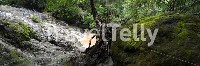 Panorama from a tree growing with roots at the rocks at Montezuma falls Costa Rica