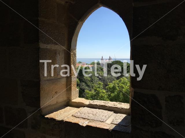 View through a window at the Castelo de S. Jorge in Lisbon Portugal