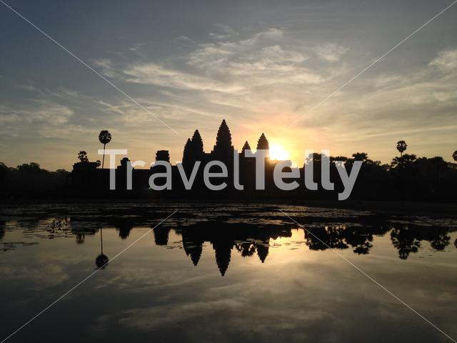 Sunrise from Angkor Wat temple complex in Cambodia and the largest religious monument in the world