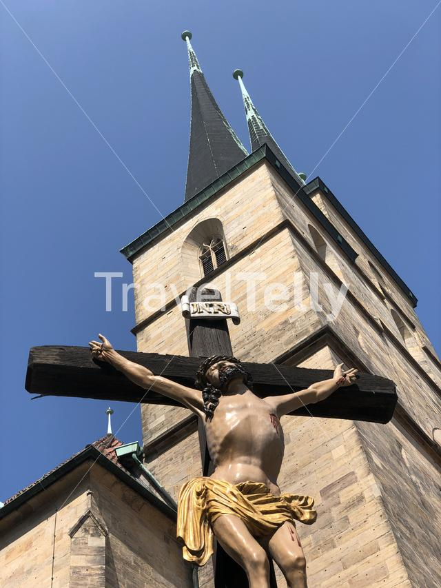 Cross statue in front of the St. Severi church in Erfurt, Germany