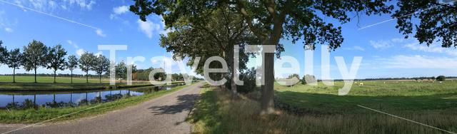 Panoramic landscape from a canal around Zwinderen in The Netherlands