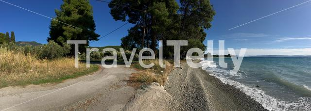 Panorama from the beach and road in Rovies Greece