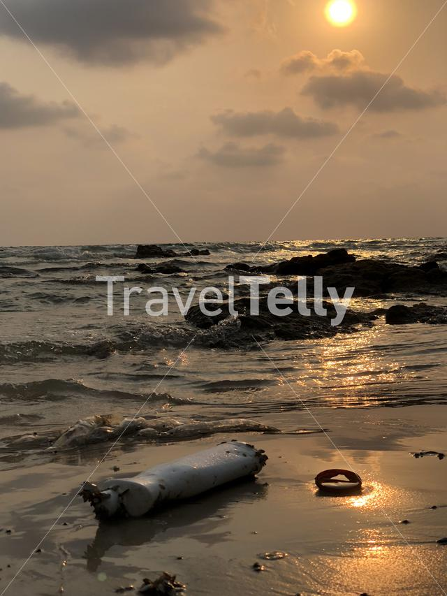 Pollution on Ao Phrao beach during sunset at Koh Samet island in Thailand