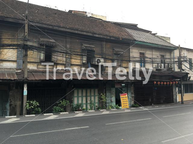 Old houses and electricity wires in Bangkok Thailand