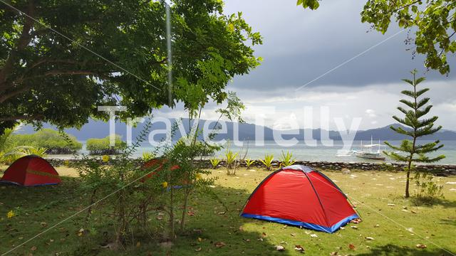 Camping on Capsalay island on Port Barton beaches