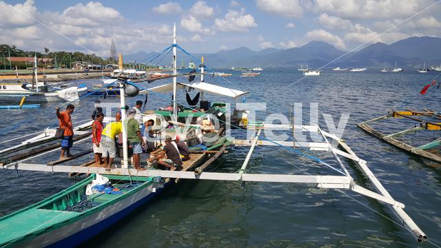 Fishermen and boats at Puerto Princesa bay, Palawan