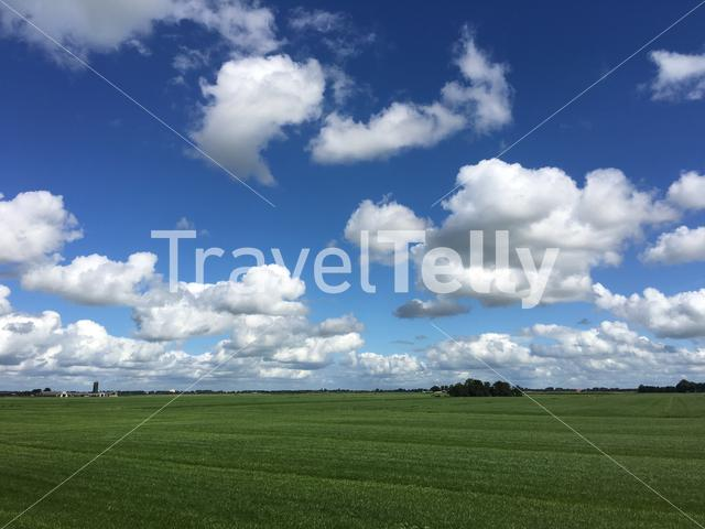 Frisian landscape with clouds in The Netherlands