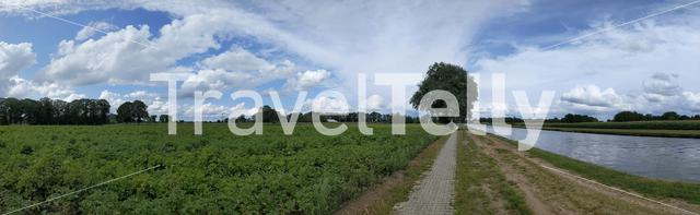 Panorama from a bicycle path next to a canal around Hardenberg, The Netherlands