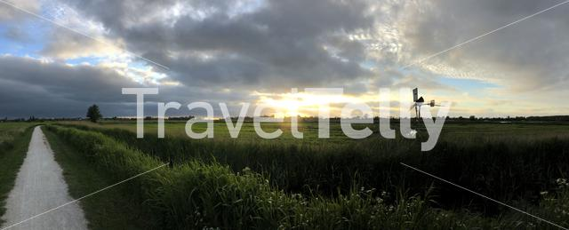 Panorama from a cloudy sunset around Sneek, Friesland The Netherlands