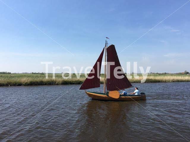 Sailboat in the Wide Wimerts in Friesland The Netherlands