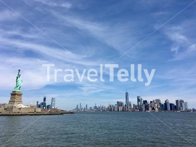 The Statue of Liberty and the skyline of Manhattan in New York City.