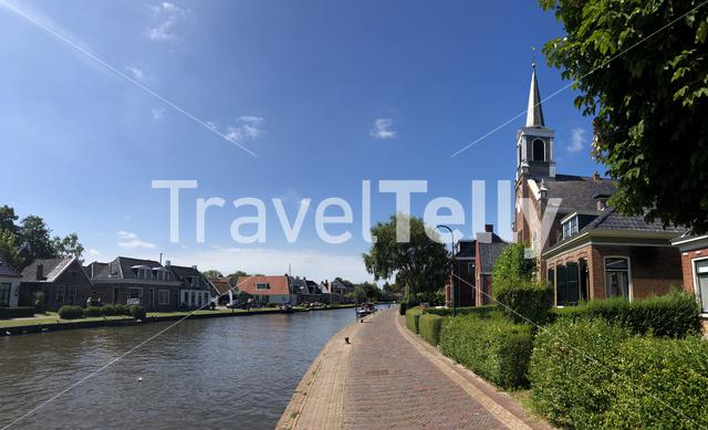 Panorama from the canal in Burdaard Friesland The Netherlands