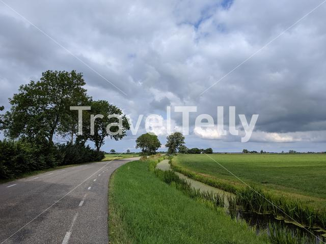 Cloudy Frisian landscape in The Netherlands