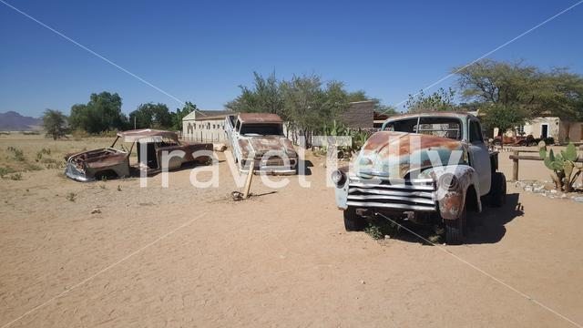 Old car wrecks at Gas station Solitaire in Namibia