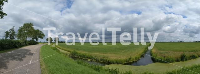 Cloudy Frisian panoramic landscape in The Netherlands