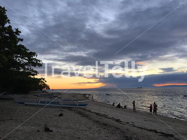Locals at the beach during sunset at Balicasag Island in Bohol the Philippines