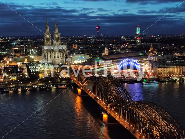 Nighttime view of Cologne cathedral and the Hohenzollern bridge as seen from the KölnTriangle tower