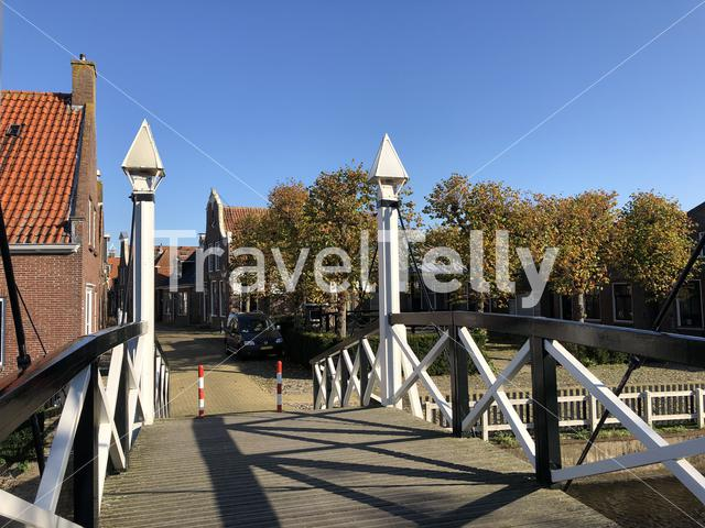 Bridge over a canal during autumn in Hindeloopen, Friesland The Netherlands