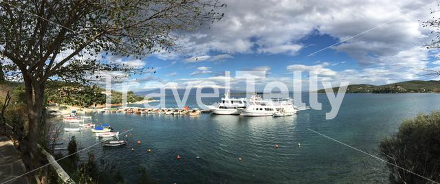 Panorama from the harbour with cruise ships and fishing boats in Amaliapoli Greece