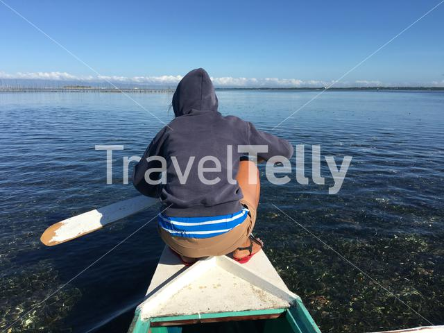 Girl in front of a Catamaran Boat during low tide in Panglao bay Bohol the Philippines