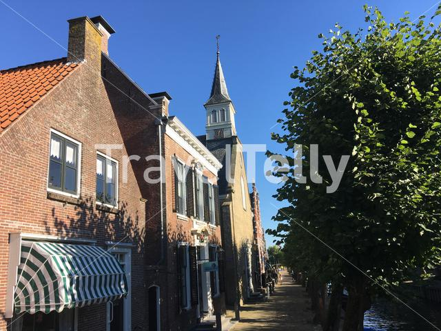 Houses and a church in Sloten Friesland The Netherlands