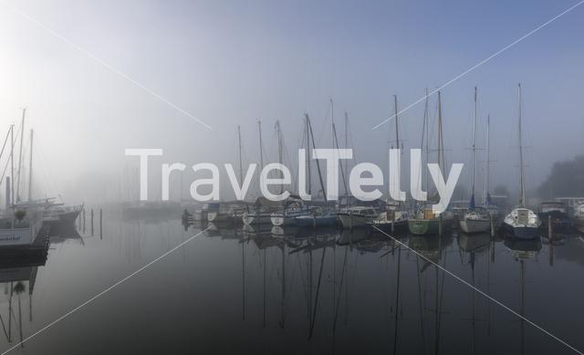 Harbor on a misty morning around the Sneekermeer in Friesland The Netherlands