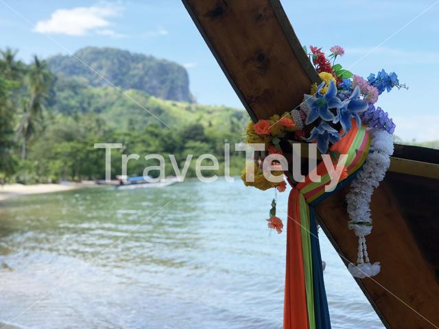 Colorful clothes tied to bow of long-tail boat in Koh Mook Thailand