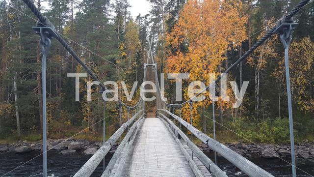 Bridge over a river in Patvinsuo National Park Finland