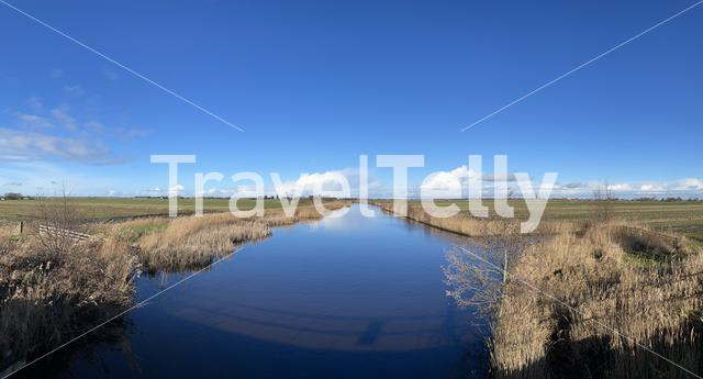 Panorama from a canal on a winter day around Broek in Friesland The Netherlands