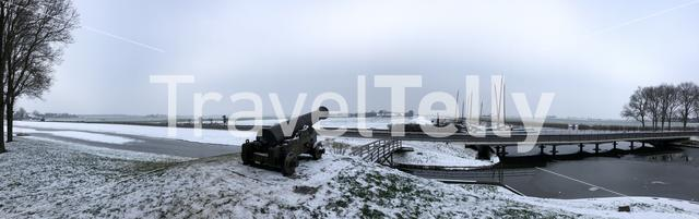 Panorama winter landscape in Sloten, Friesland, The Netherlands