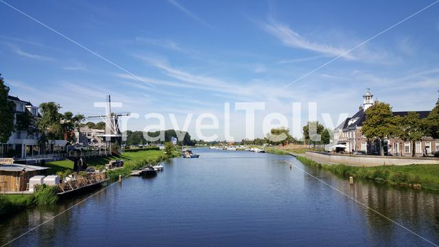 Dutch windmill on the banks of the river Vechte in Ommen The Netherlands