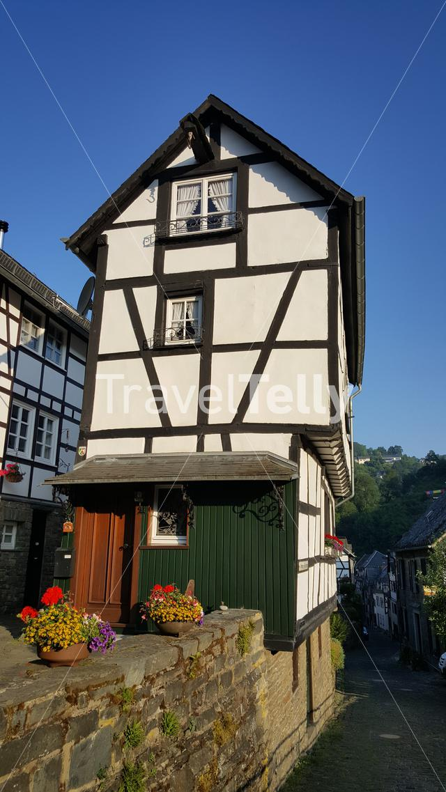 Typical German old house in Monschau at sunrise