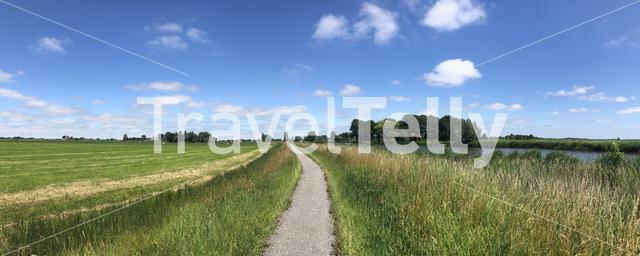 Bicycle path through Friesland in The Netherlands